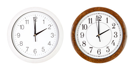 Two clock faces showing two o'clock