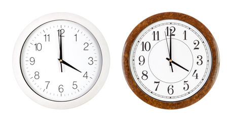 Two clock faces showing four o'clock