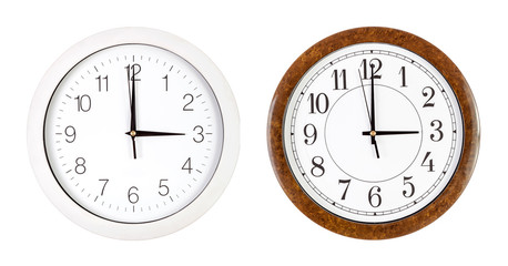 Two clock faces showing three o'clock