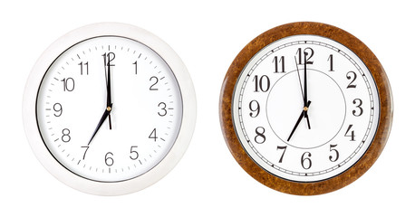 Two clock faces showing seven o'clock