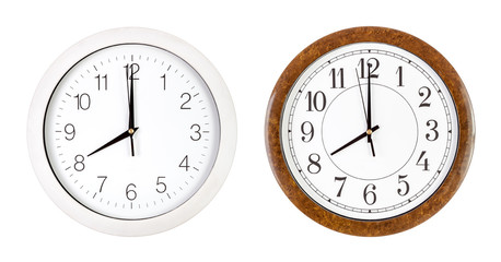 Two clock faces showing eight o'clock
