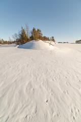 Winter, coast of the frozen lake.