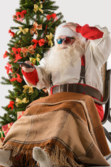 Santa Claus watching tv or home theater wearing 3d glasses