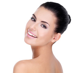 Wall Mural - Beautiful face of young woman with clean skin