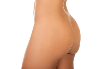Beautiful buttocks of a nude woman. Close up.