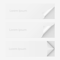 set of white paper with curled corner