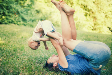 Mother and son having fun on the grass