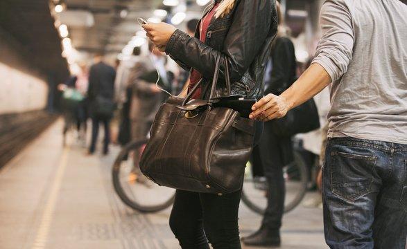 Thief stealing wallet at the subway station