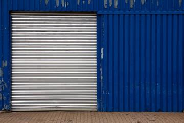 Shut Door on Blue Metal Shed