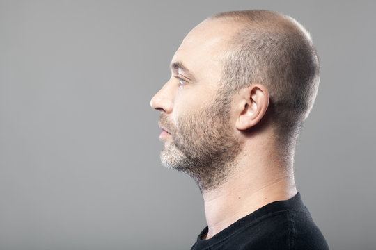 profile portrait of man isolated on gray background with copyspa