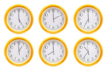Group of wall clocks isolated on white background