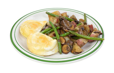 Pierogi with vegetables meal on a dish