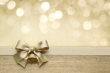 Golden ribbon bow with bokeh