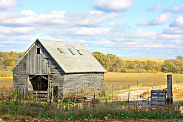 Old Wooden Abandoned Farm Building and Landscape