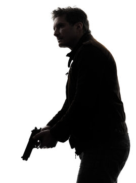 man killer policeman holding gun silhouette