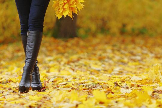 Woman feet  in autumn park