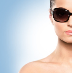 Portrait of a young and attractive woman in sunglasses
