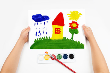 Child draws the home watercolors