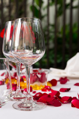 Wine glass table set with rose petals decorations