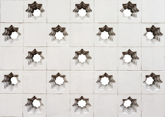 moroccan style star perforated wall texture background