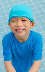 Happy asian boy in swiming pool