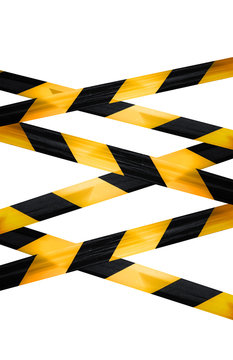 Black and yellow caution striped tapes isolated on white