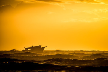 boat in a yellow sunrise