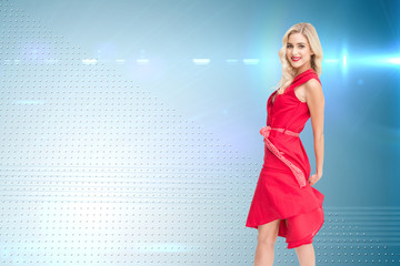 Composite image of smiling blonde turning