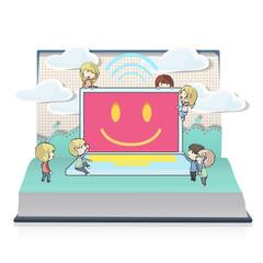 Kids around modern laptop on book.