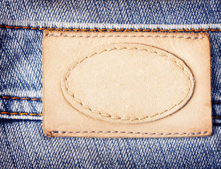 Brown leather jeans label sewed on jeans.