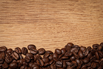roasted coffee beans on wooden texture