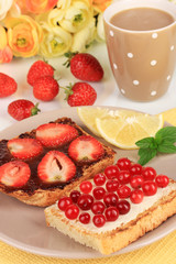 Delicious toast with berries on table close-up