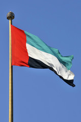 United Arab Emirates flag at Jumeirah against clear blue sky