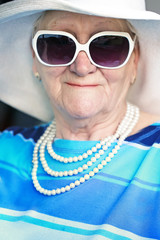 smiling senior woman in sunglasses