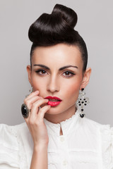 Close Up of vintage styling model with makeup and updo