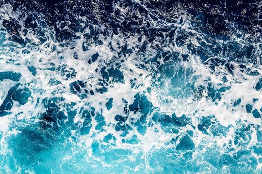 Deep blue sea water with spray