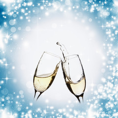 Glasses with champagne and holiday lights