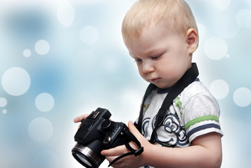 Little boy with photo camera