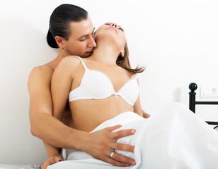 Man kissing girl in neck