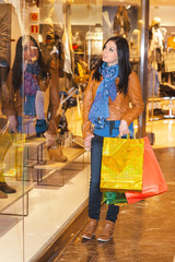 Young girl dressed in fashion goes shopping