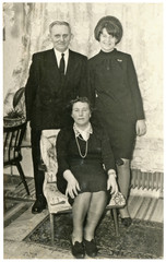 Father, mother and adult daughter, family - circa 1960