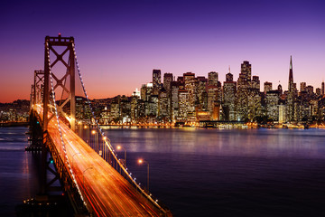 Fototapete - San Francisco skyline and Bay Bridge at sunset, California