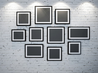 frames on brick wall