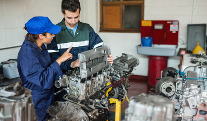 Instructor explaining engine to trainee