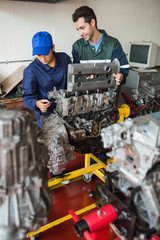 Trainee and instructor checking engine