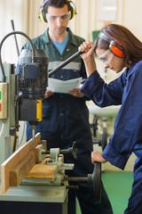 Focused trainee using drill