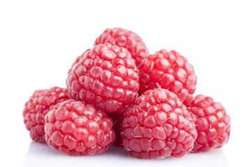 Ripe raspberrys isolated on a white background