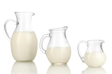 Milk in jugs isolated on white