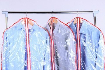 Office male clothes in cases for storing