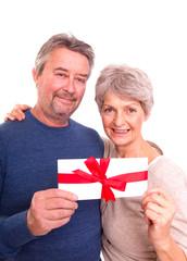 senioren mit gutschein